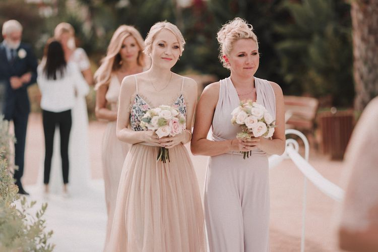 Bridesmaids in Different Blush Outfits | Blush Pink & White Marbella Beach Wedding at El Chiringuito, Puente Romano |  Kino Ortega Photographer