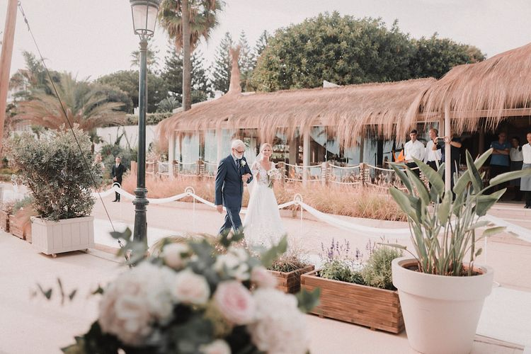 Wedding Ceremony | Bridal Entrance in Yaki Ravid Gown | Blush Pink & White Marbella Beach Wedding at El Chiringuito, Puente Romano |  Kino Ortega Photographer