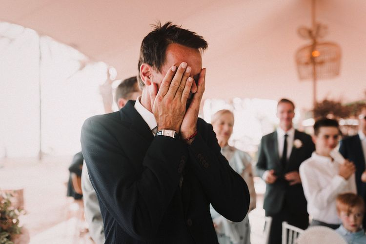 Wedding Ceremony | Emotional Groom at the Altar in Armani | Blush Pink & White Marbella Beach Wedding at El Chiringuito, Puente Romano |  Kino Ortega Photographer