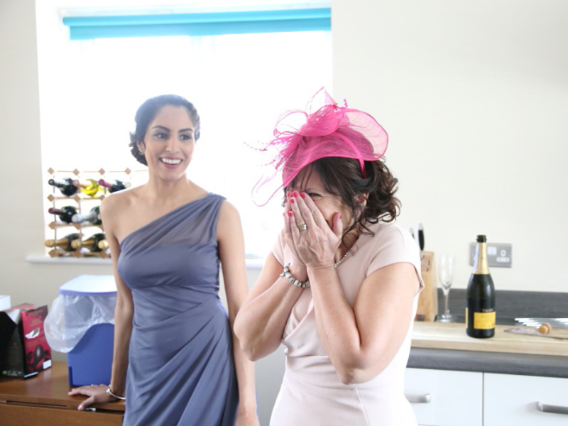 Mother of the bride seeing daughter for the first time
