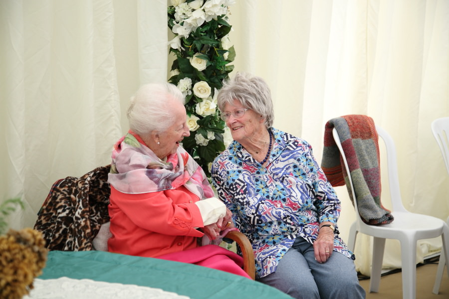 sisters at 100th birthday party in bury st edmunds suffolk
