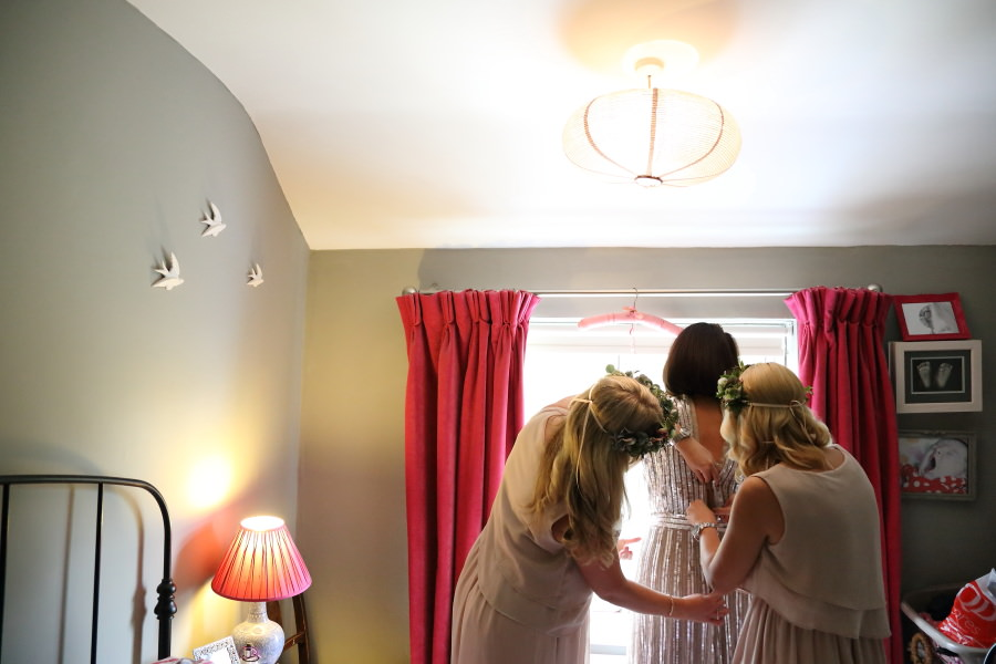 getting the dress on, alternative wedding photography bishops stortford