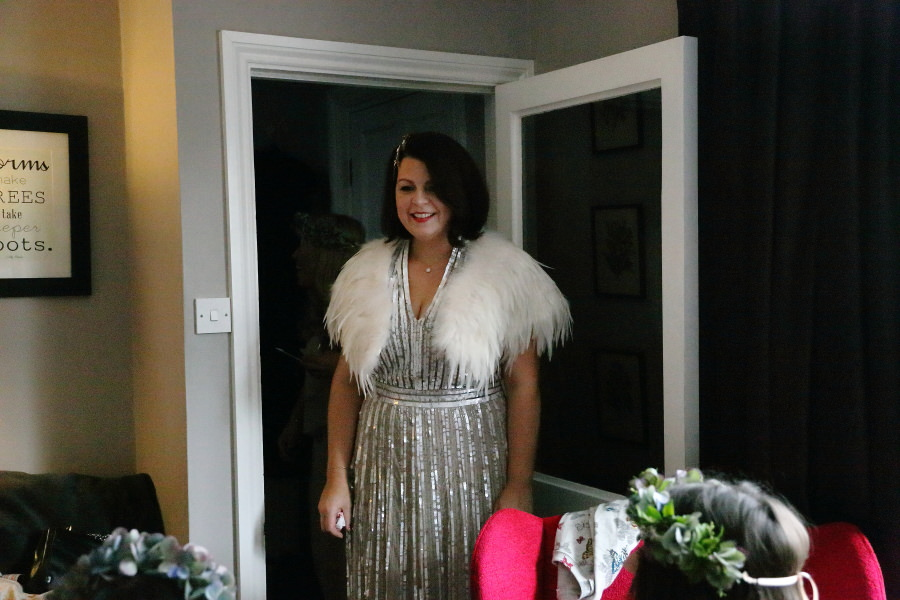 sparkly sequin wedding dress and feather shrug, quirky bishops stortford wedding
