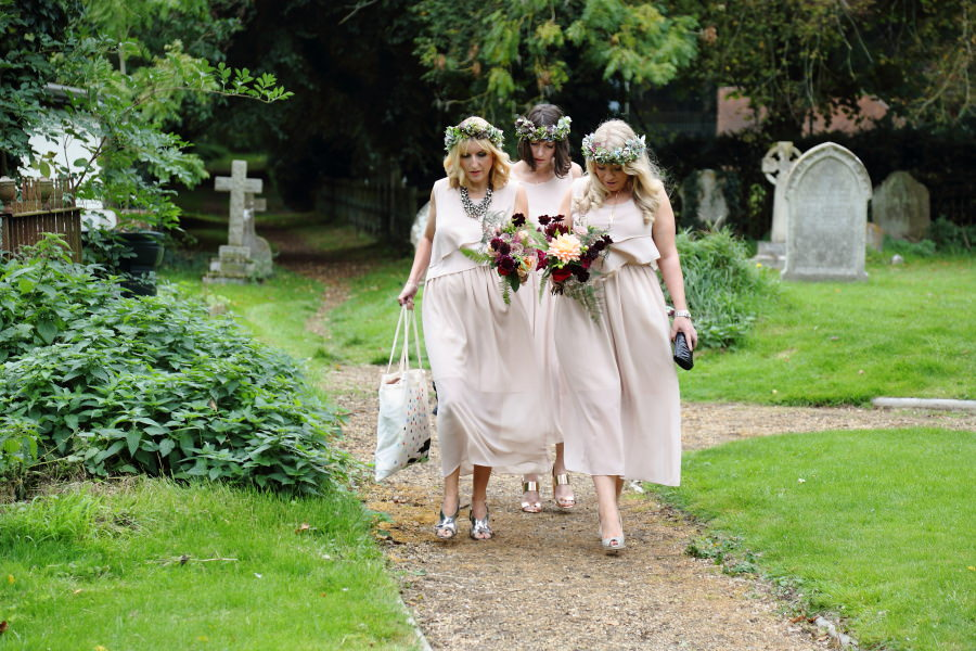 chic neutral bridesmaids arriving at the church in Manuden, Essex