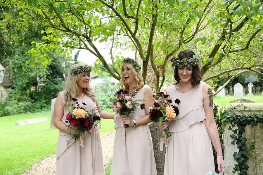 laughing bridesmaids at manuden church