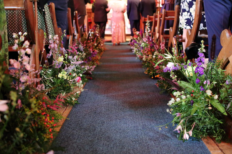 beautiful floral walk way down the aisle at manuden church, by Violets and Velvet florist