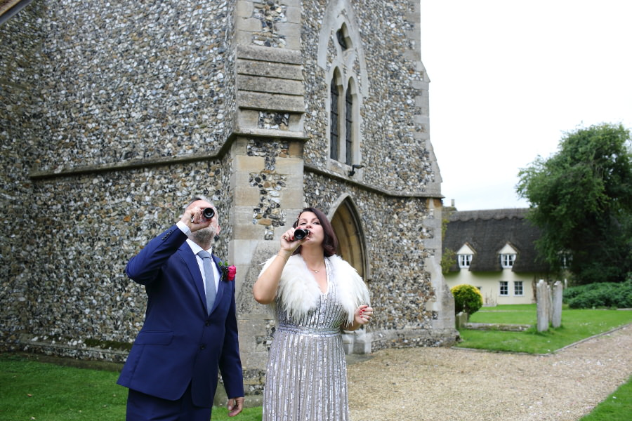 mini champagne bottles, bride and groom outside the church at manuden