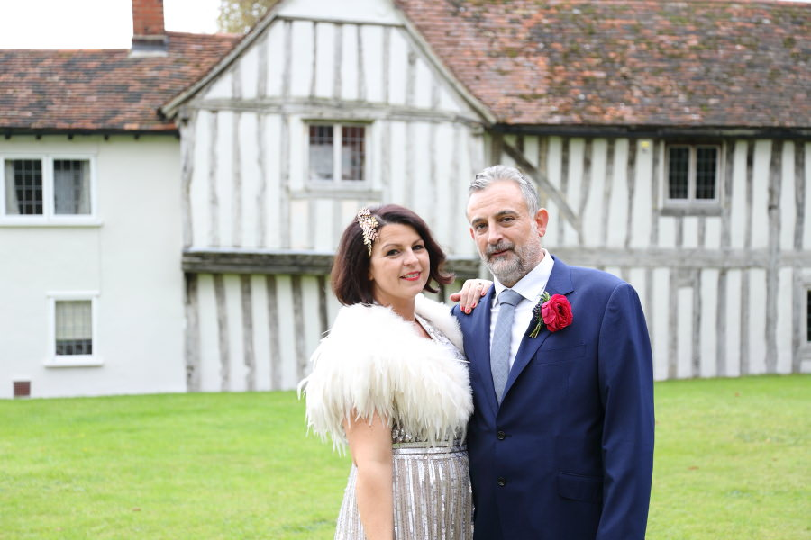 beautiful historic buildings and quirky fun couple at manuden wedding