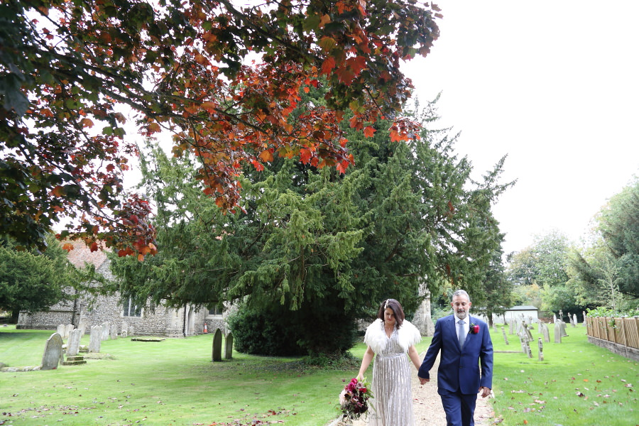red leaves on the trees at autumn wedding in manuden essex