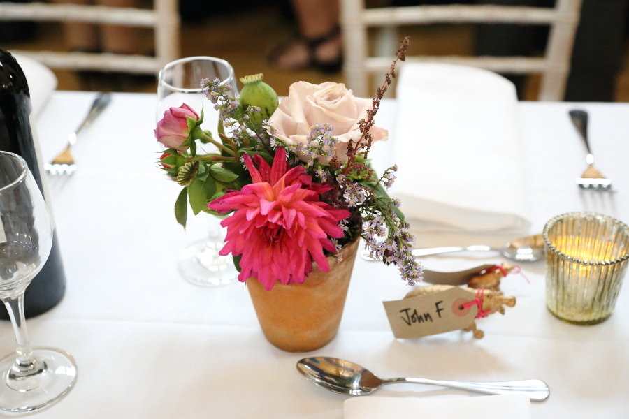 quirky flowers in teracotta pots in manuden vilage hall wedding