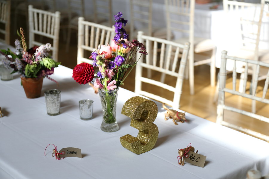 sparkly golden numbers and beautiful flowers at manuden village hall