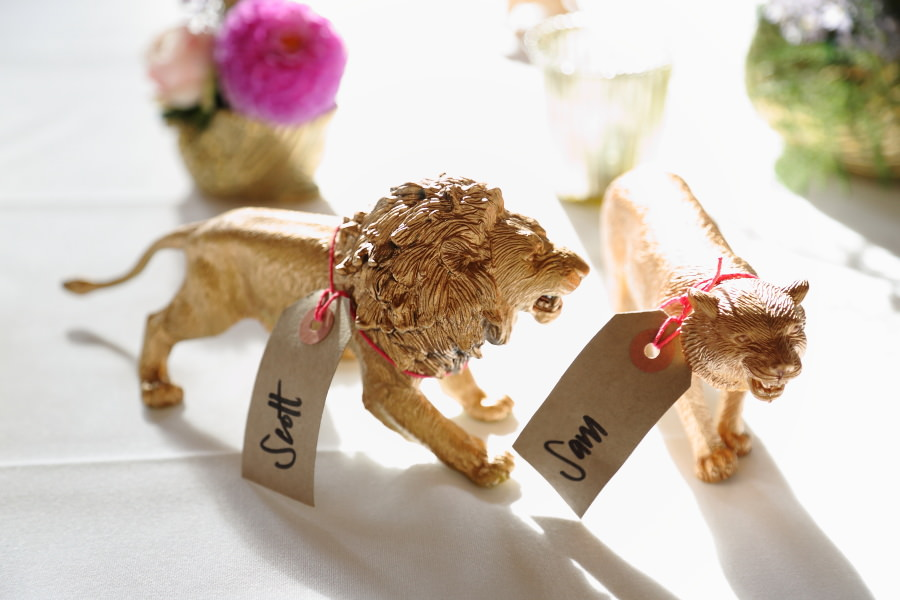 golden tiger and lion as place names at alternative wedding, manuden village hall Essex