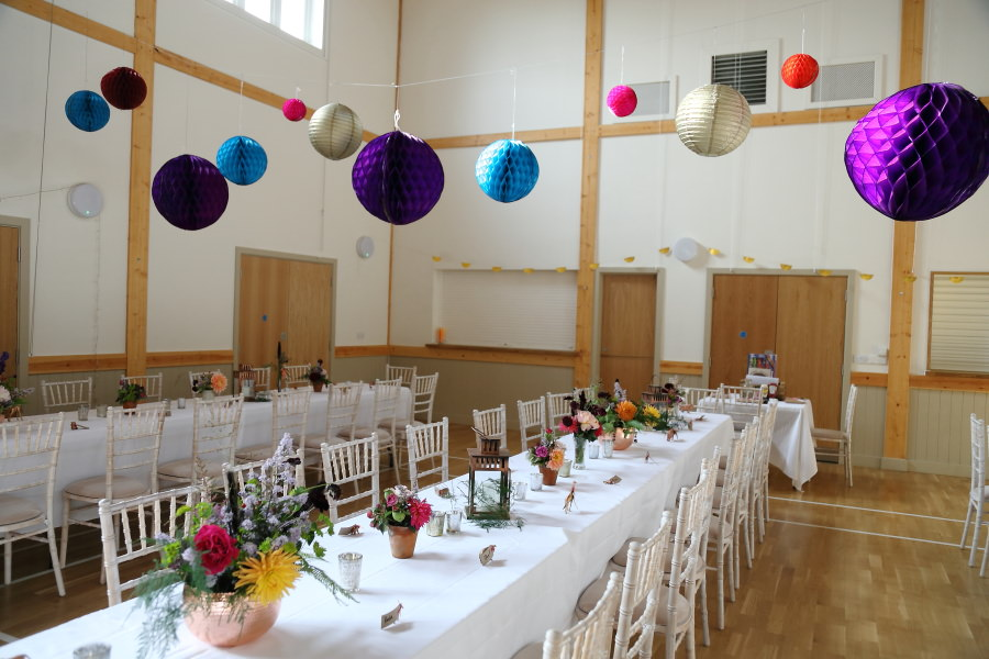 colourful paper lantern decorations at manuden village hall wedding