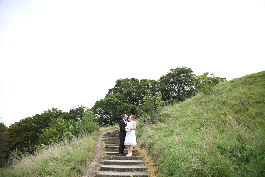on the steps on the hill at cambridge shire hall wedding