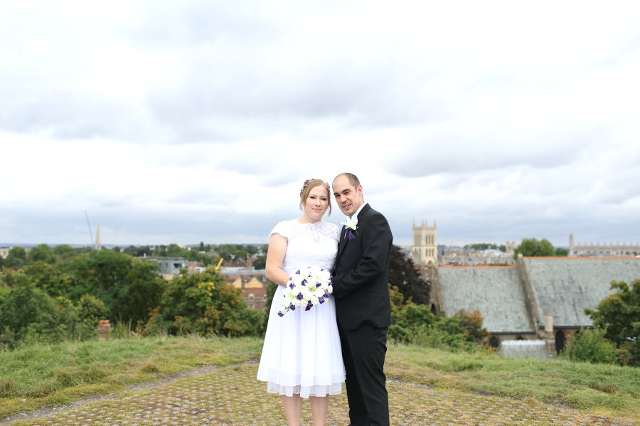 couples portrait on top of the hill overlooking Cambridge, shire hall wedding