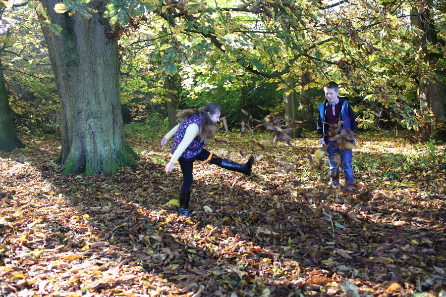 kicking the leaves at suffolk family photography