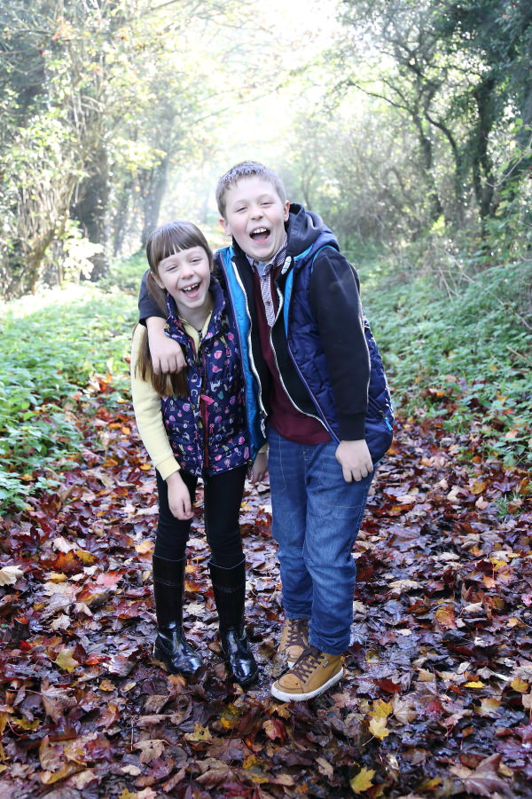 laughter at family photo shoot in woodland suffolk