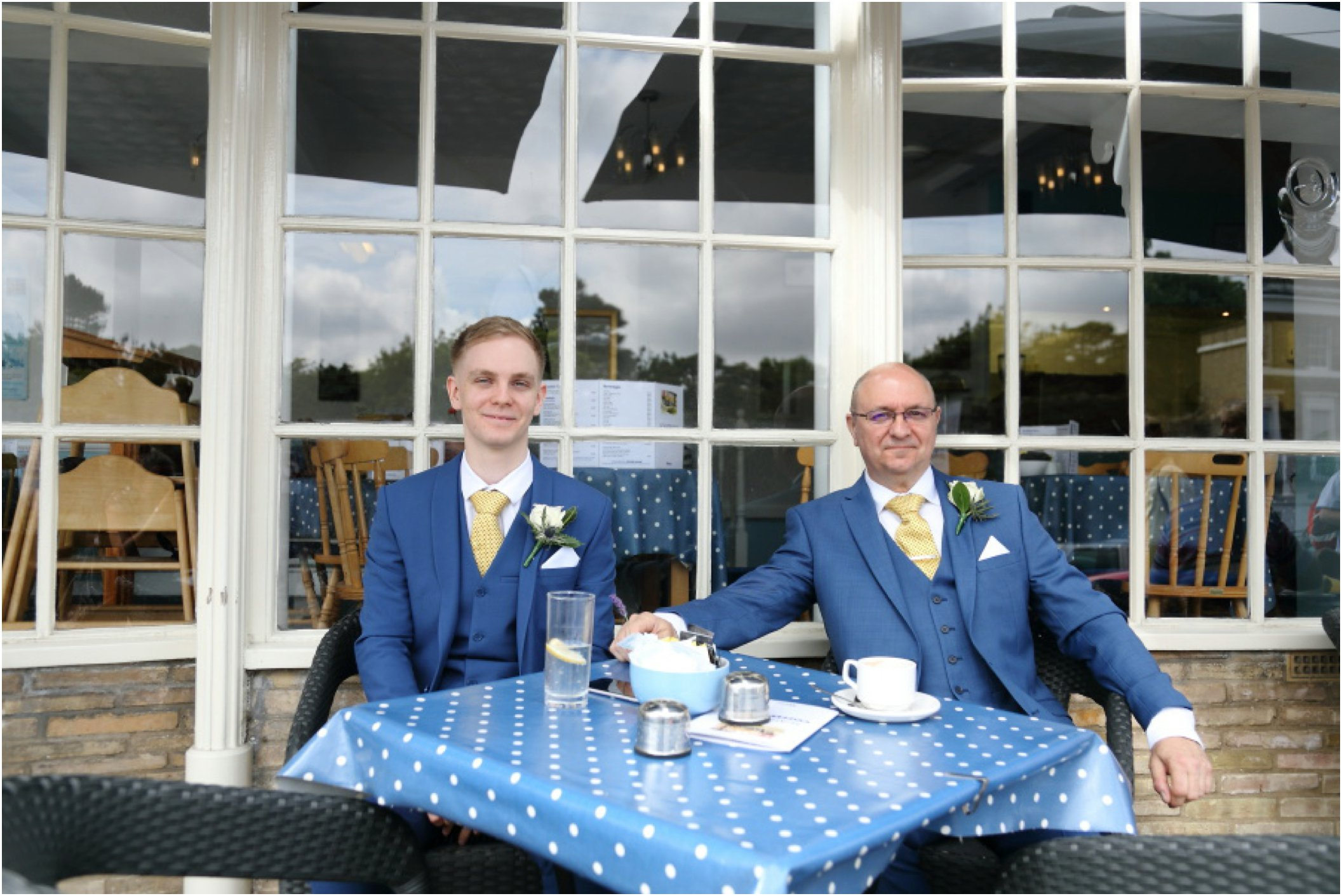 groom and best man waiting outside a cafe in Bury St Edmunds