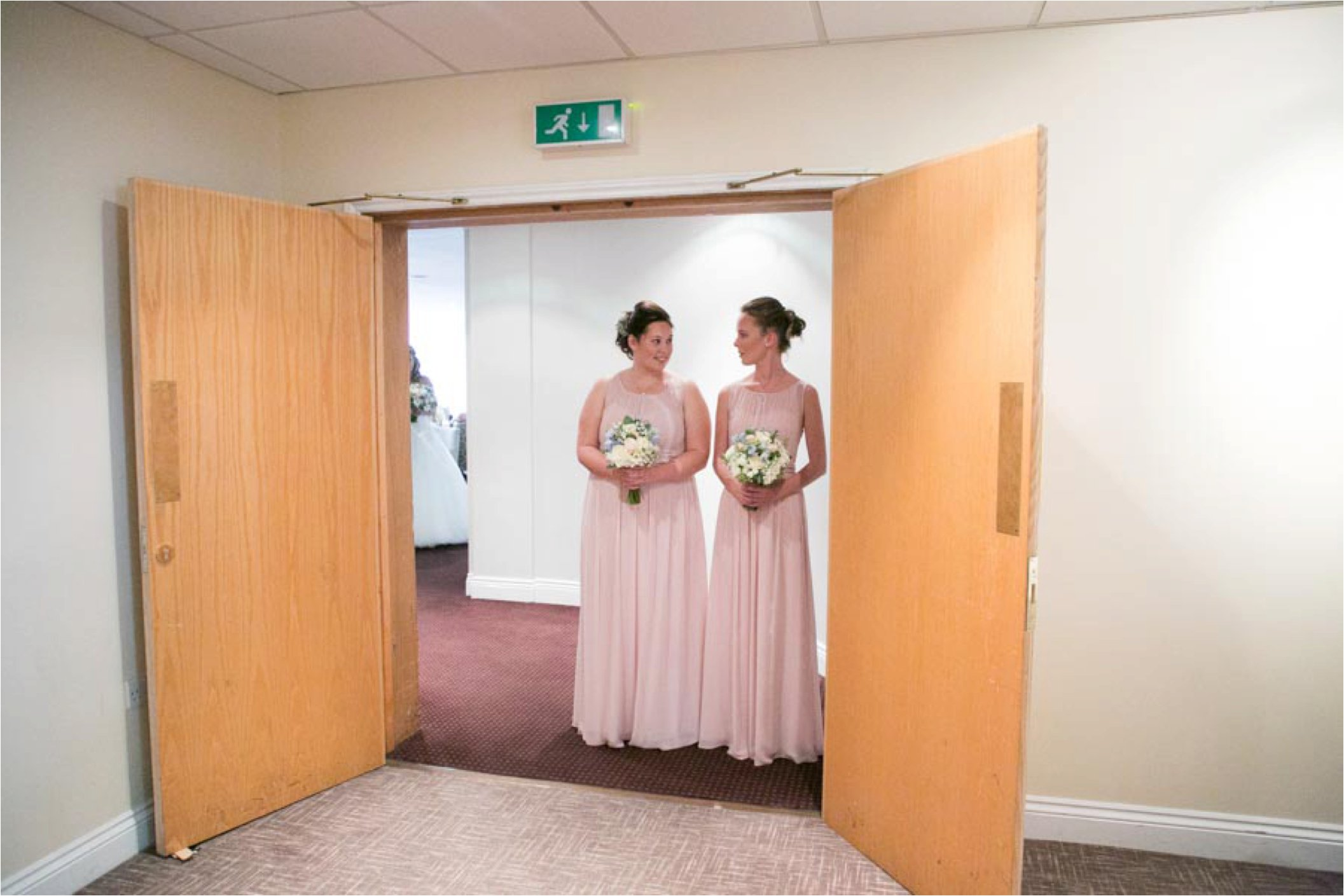 bridesmaids waiting to enter at essex wedding