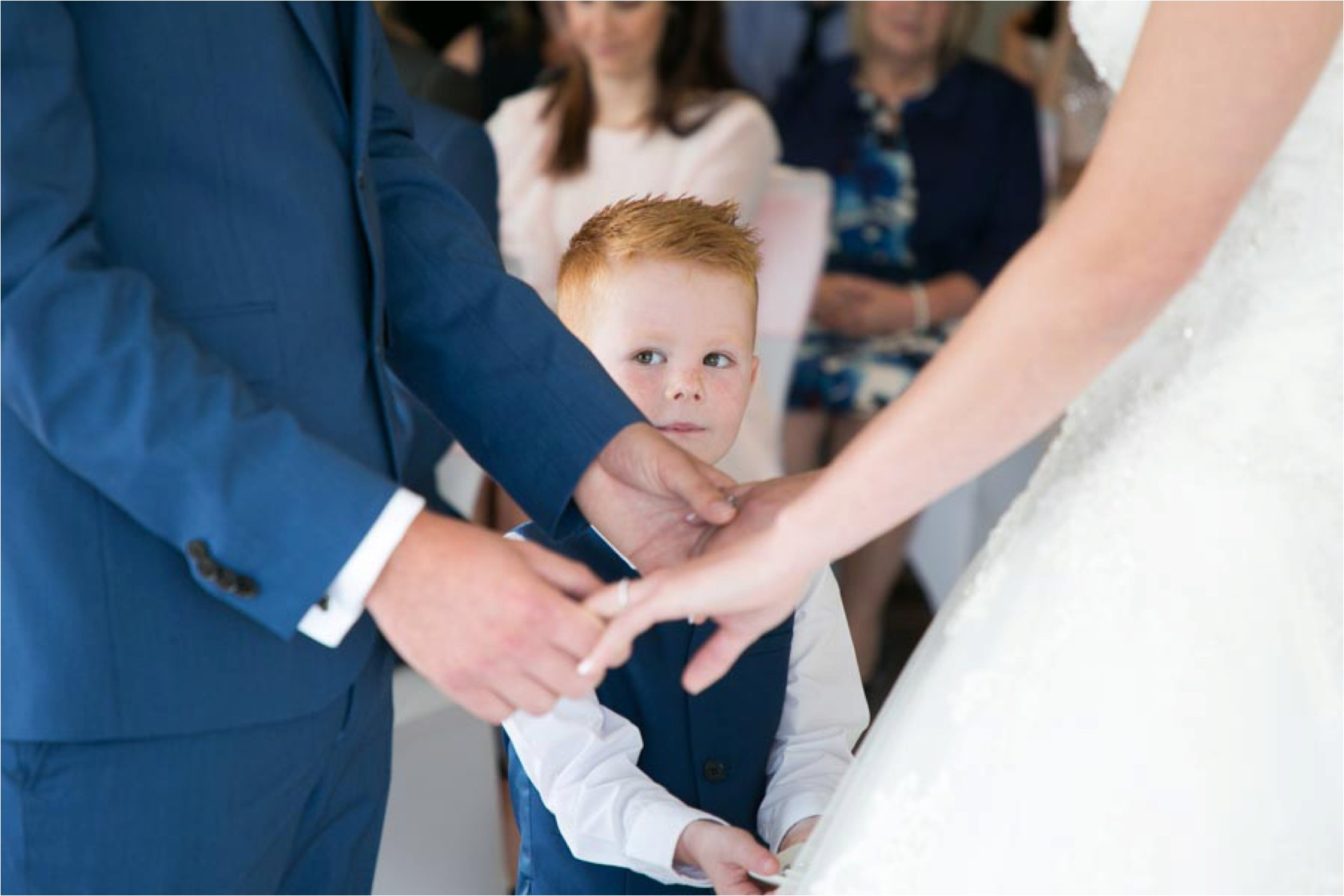 young page boy overseeing wedding stoke by nayland
