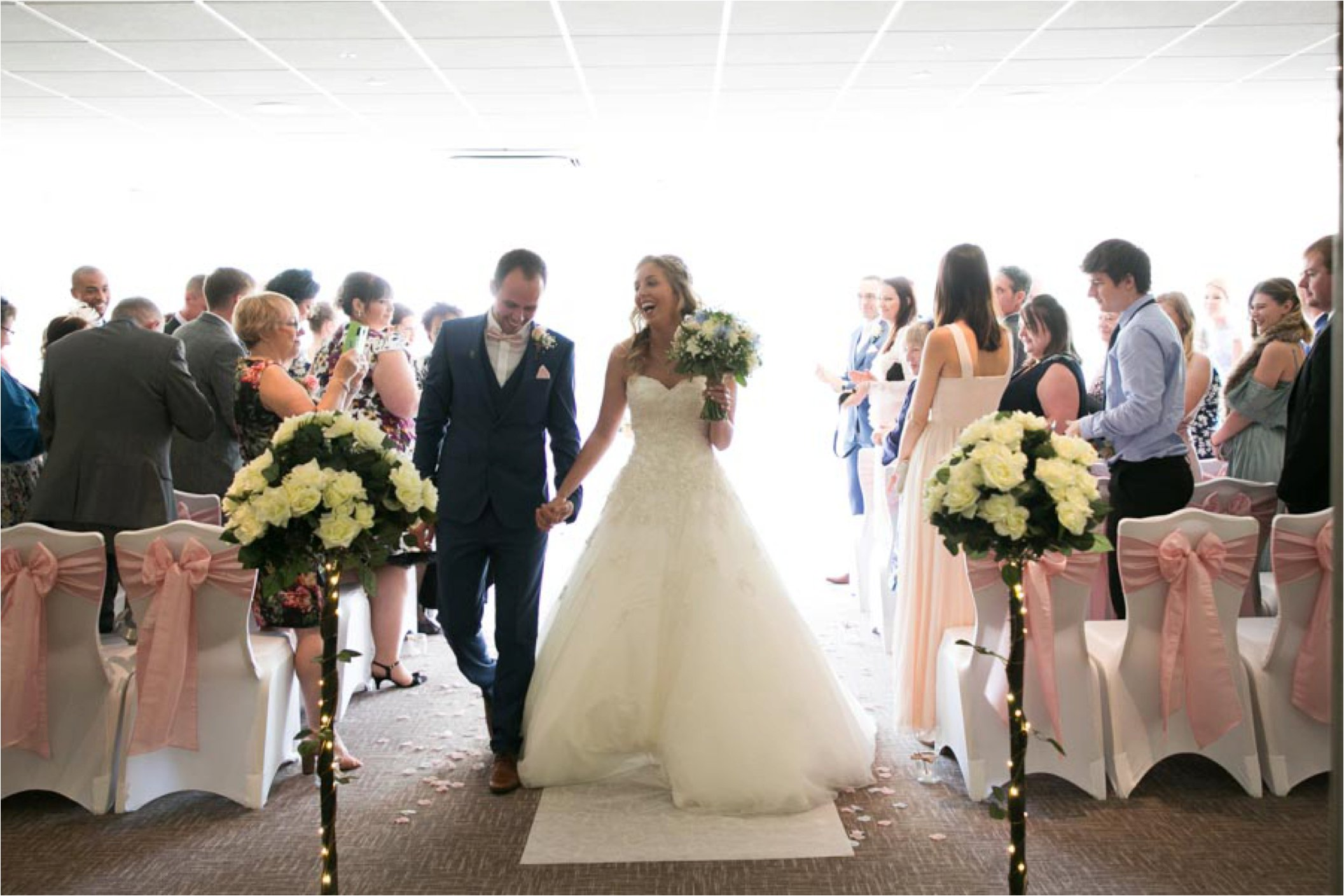 leaving the ceremony at stoke by nayland golf club wedding