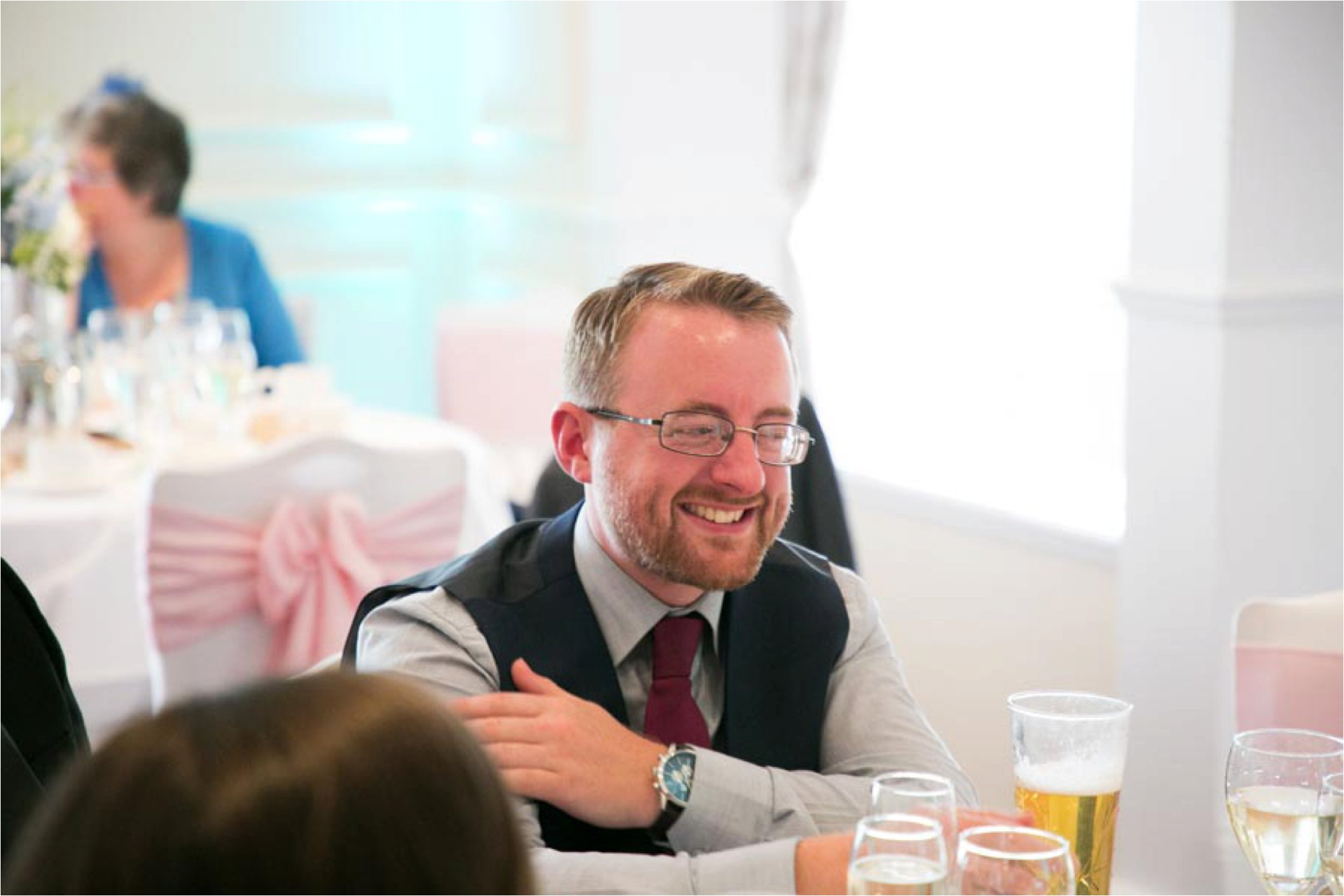 laughing guest at essex wedding reception