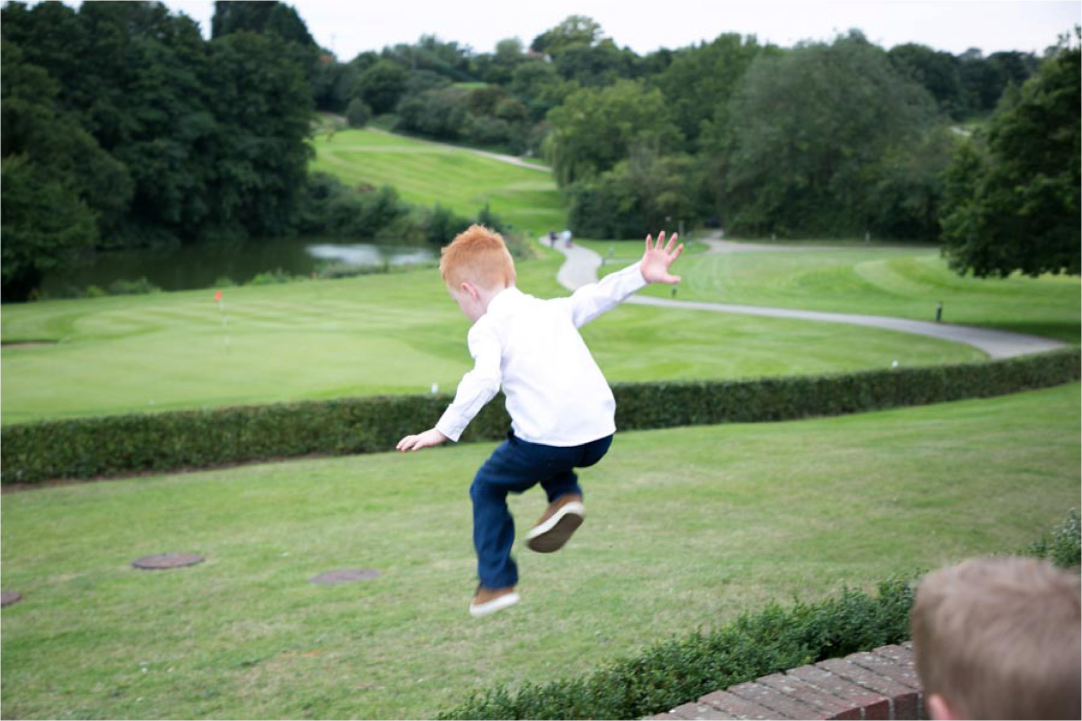 jumping child at stoke by nayland wedding