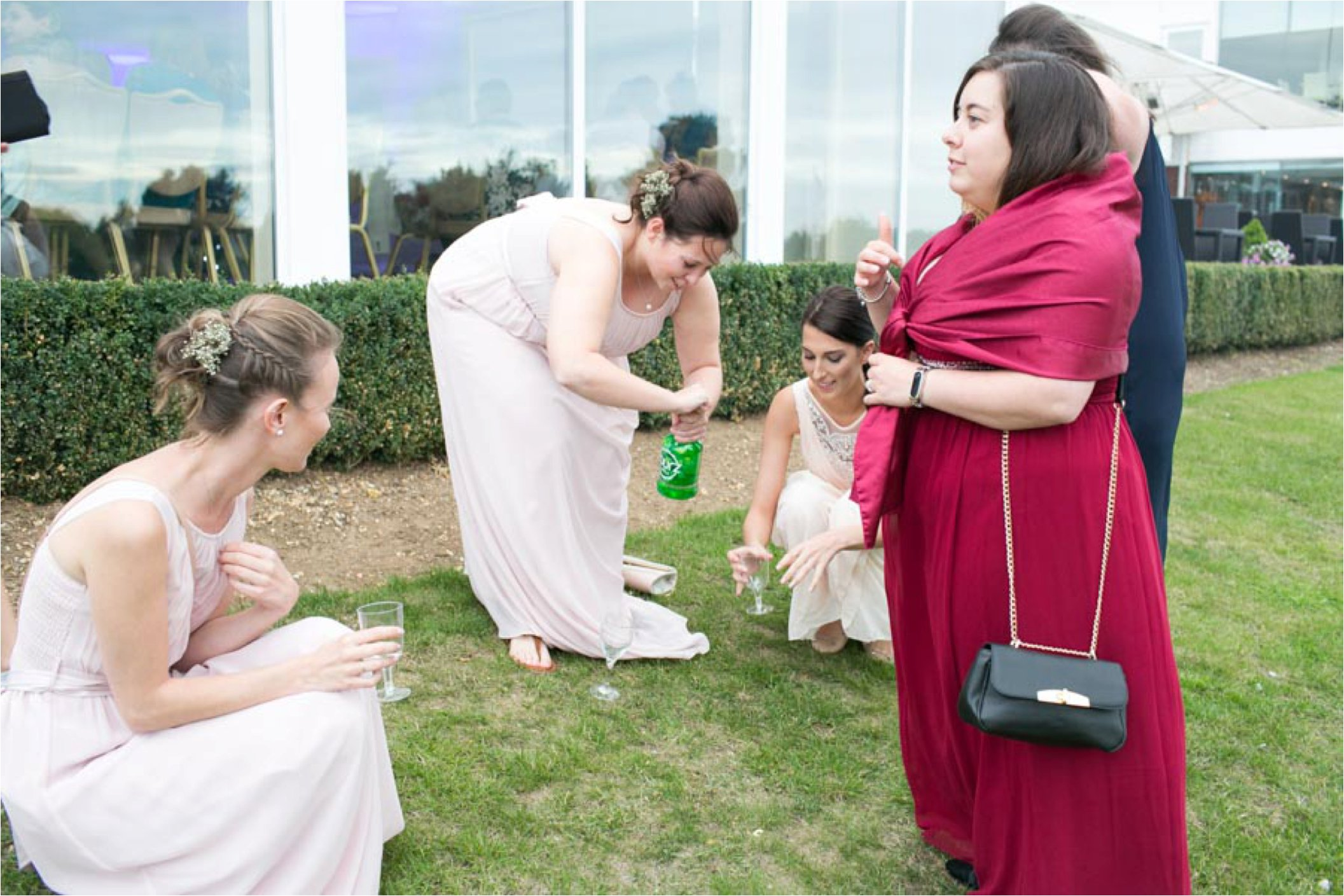 bridesmaids drinking sourz at stoke by nayland wedding