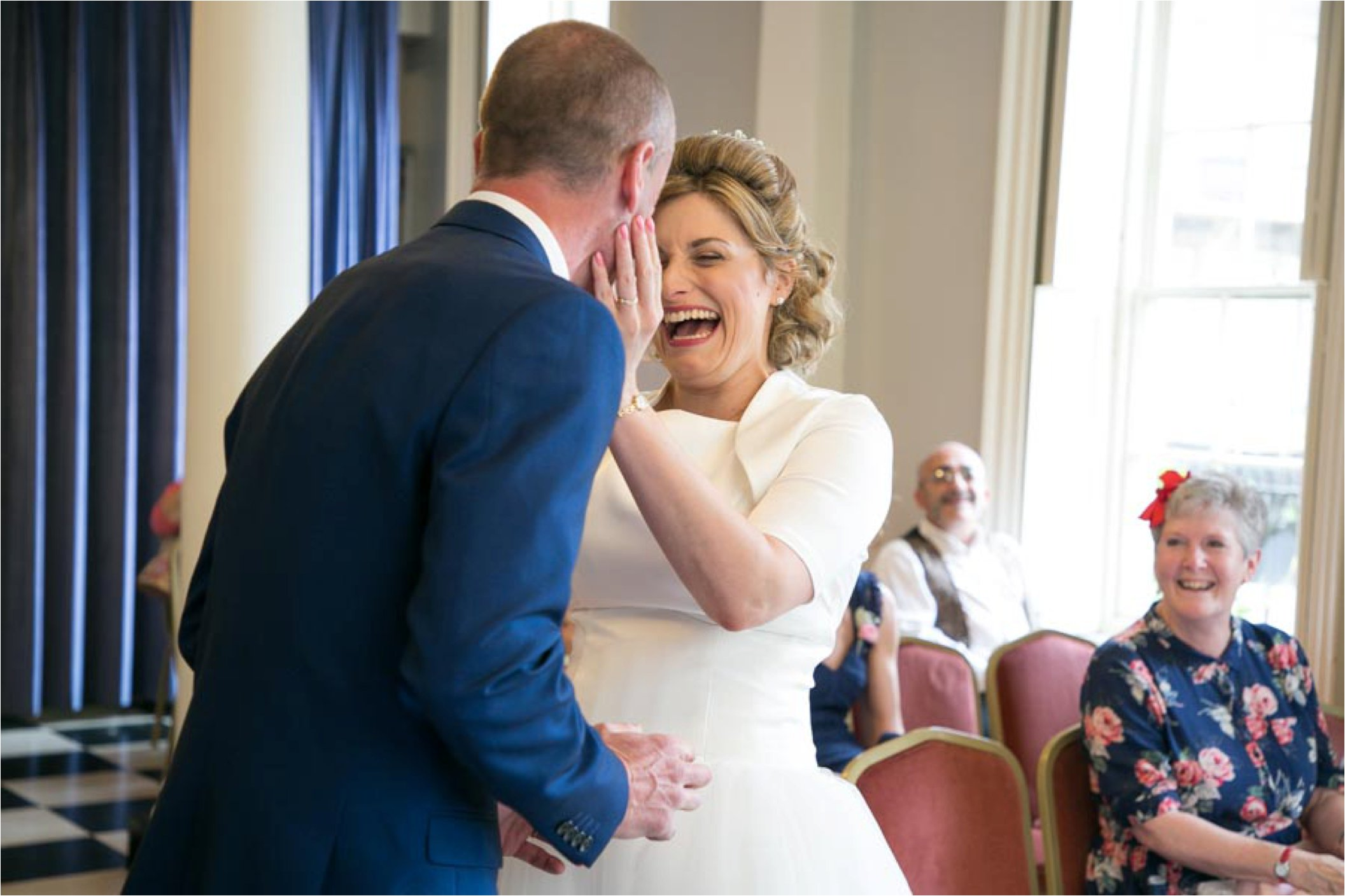 laughing couple at Athenaeum small intimate wedding Bury St Edmunds