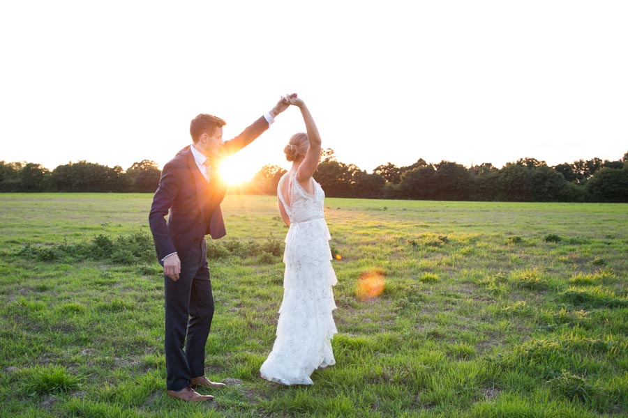 bride and groom dancing in the evening sun at Copdock Hall wedding