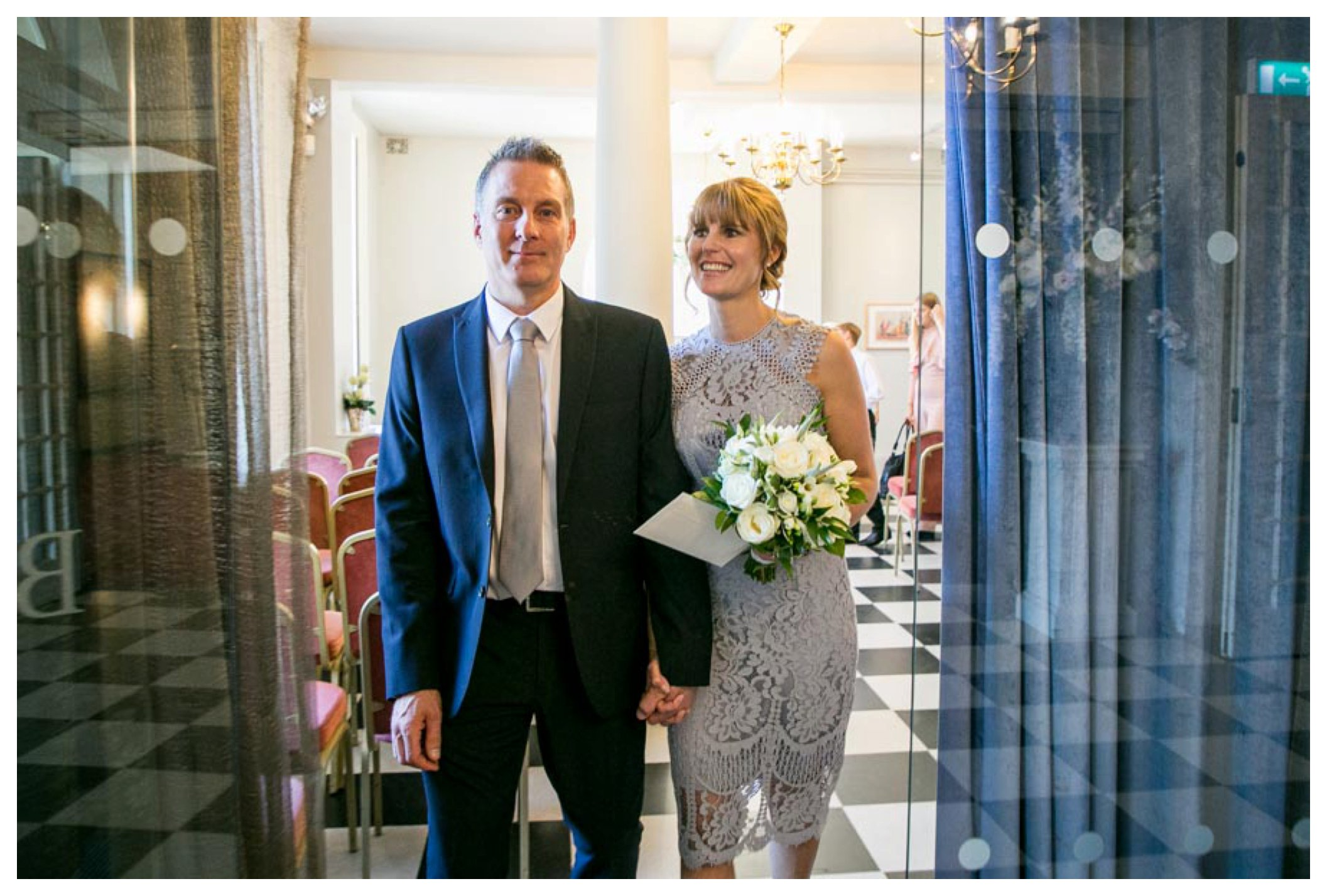 bride and groom leaving wedding ceremony at Athenaeum Bury St Edmunds