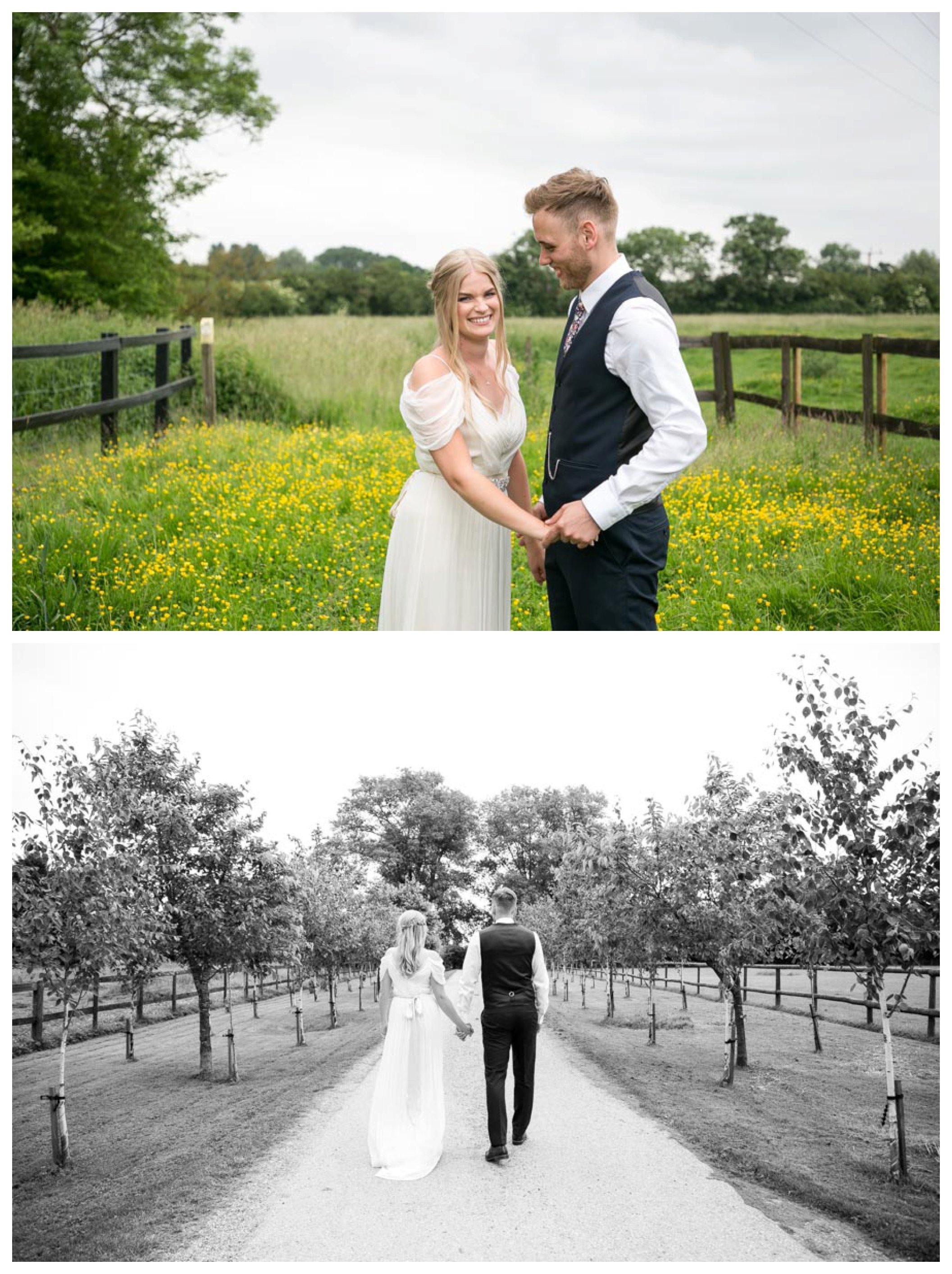 bride and groom stand smiling by yellow flowers in a field, bride and groom wald along tree lined path away from us
