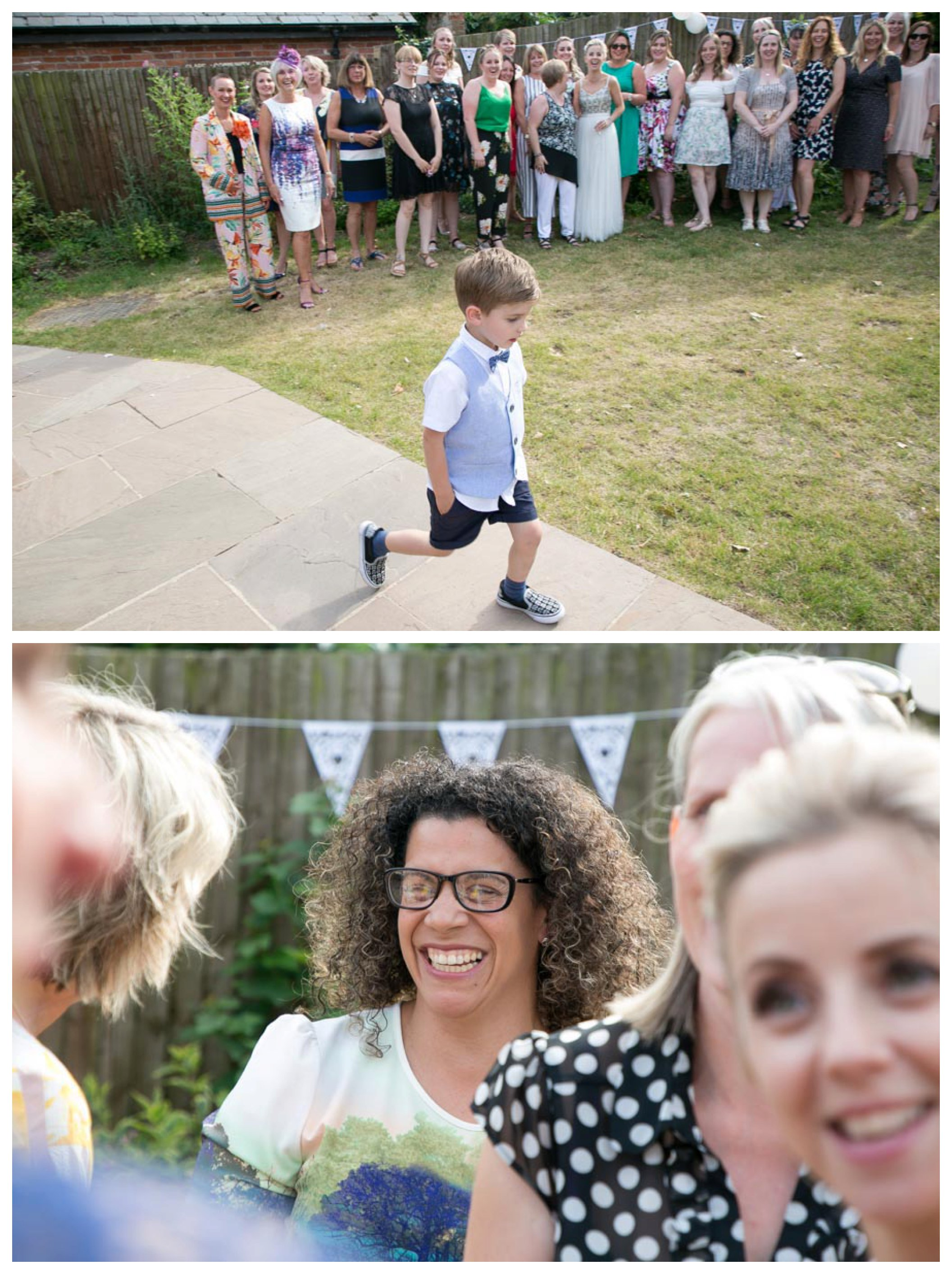 little boy walking past large group ready for photos, smiling wedding guest