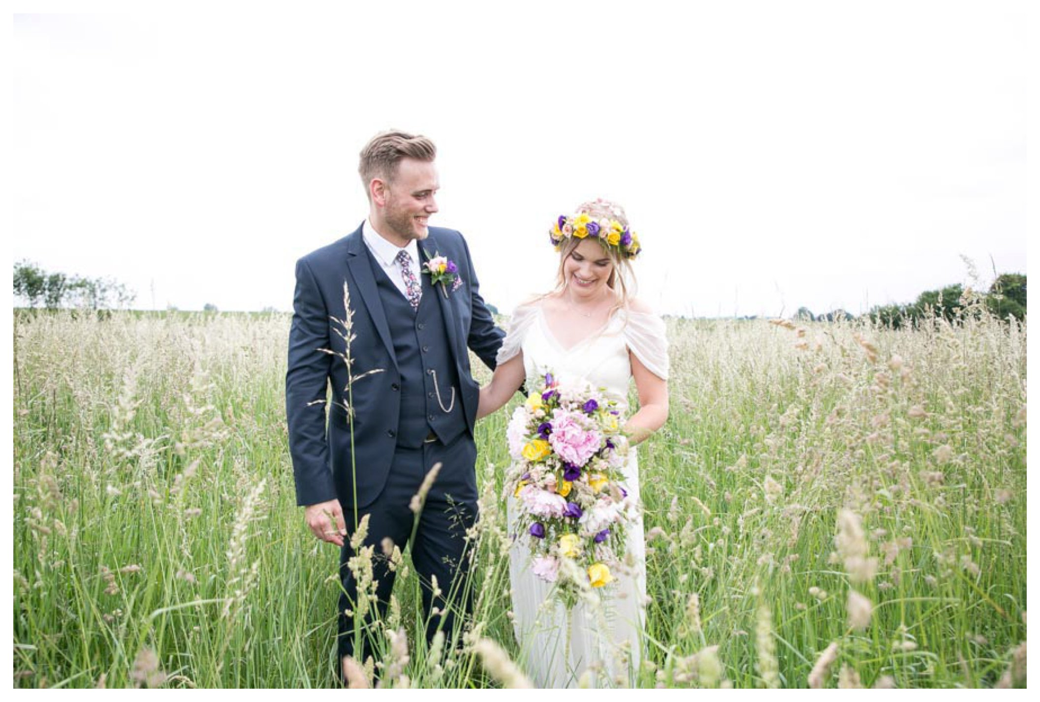 laughing bride and groom in corn field, bride with flower crown, reid Rooms wedding