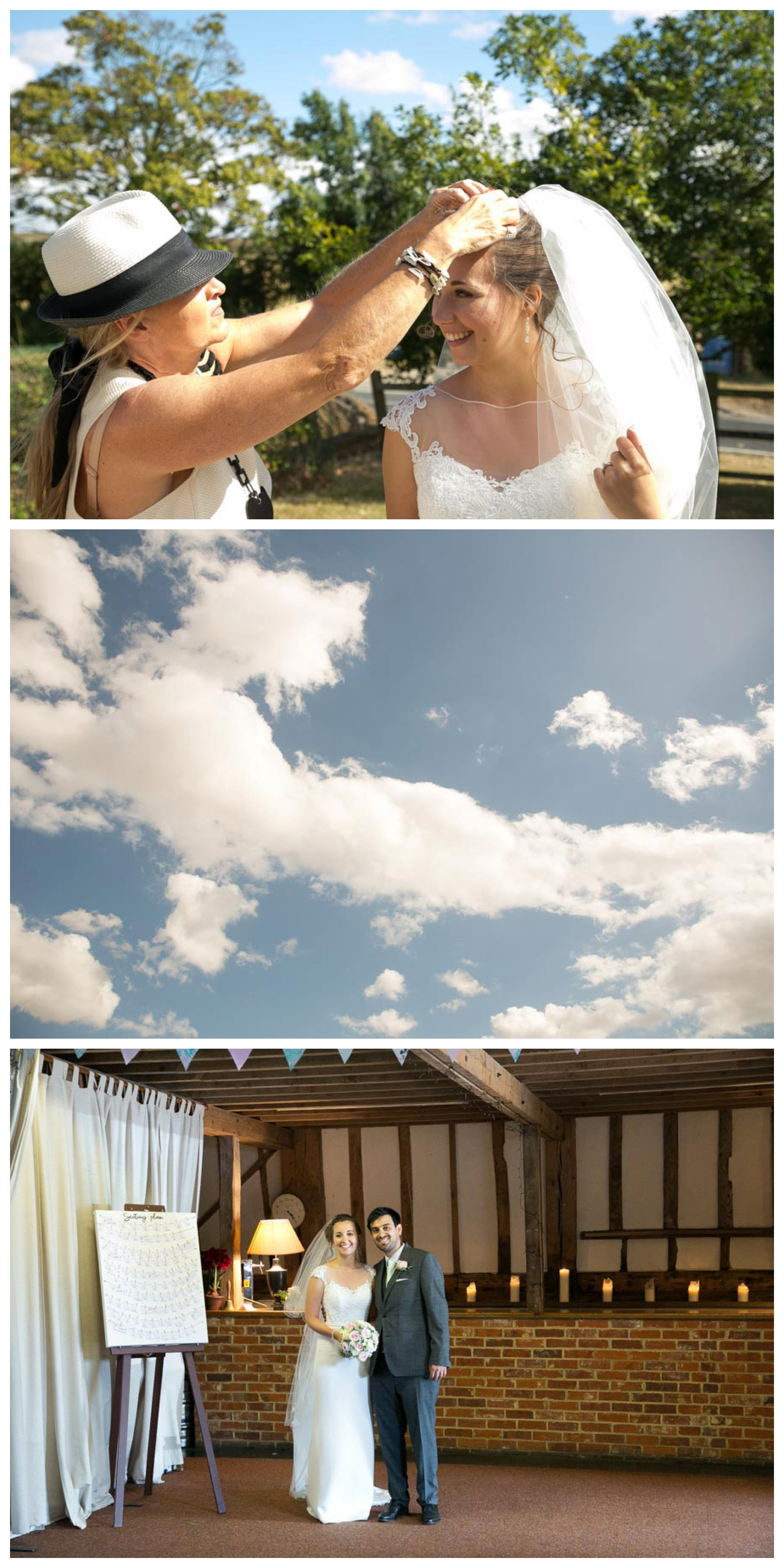 guest fixing brides veil, pretty summer sky and bride and groom about to enter the barn for their wedding