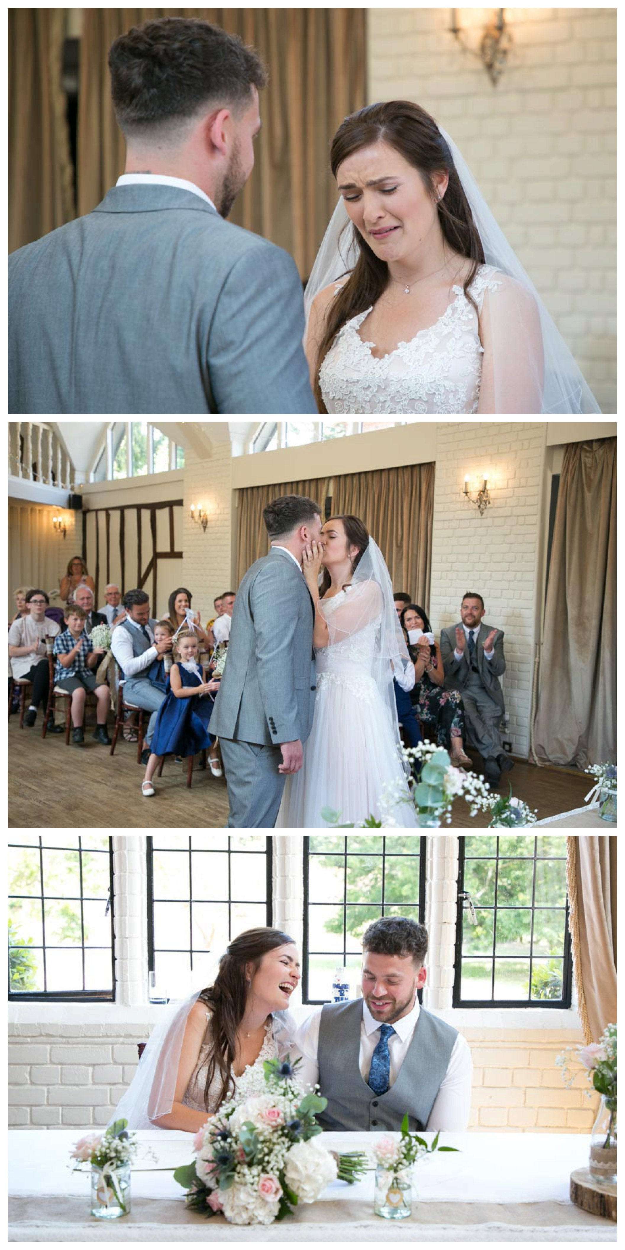 tearful bride at seckford hall wedding ceremony and laughing as they sign the register