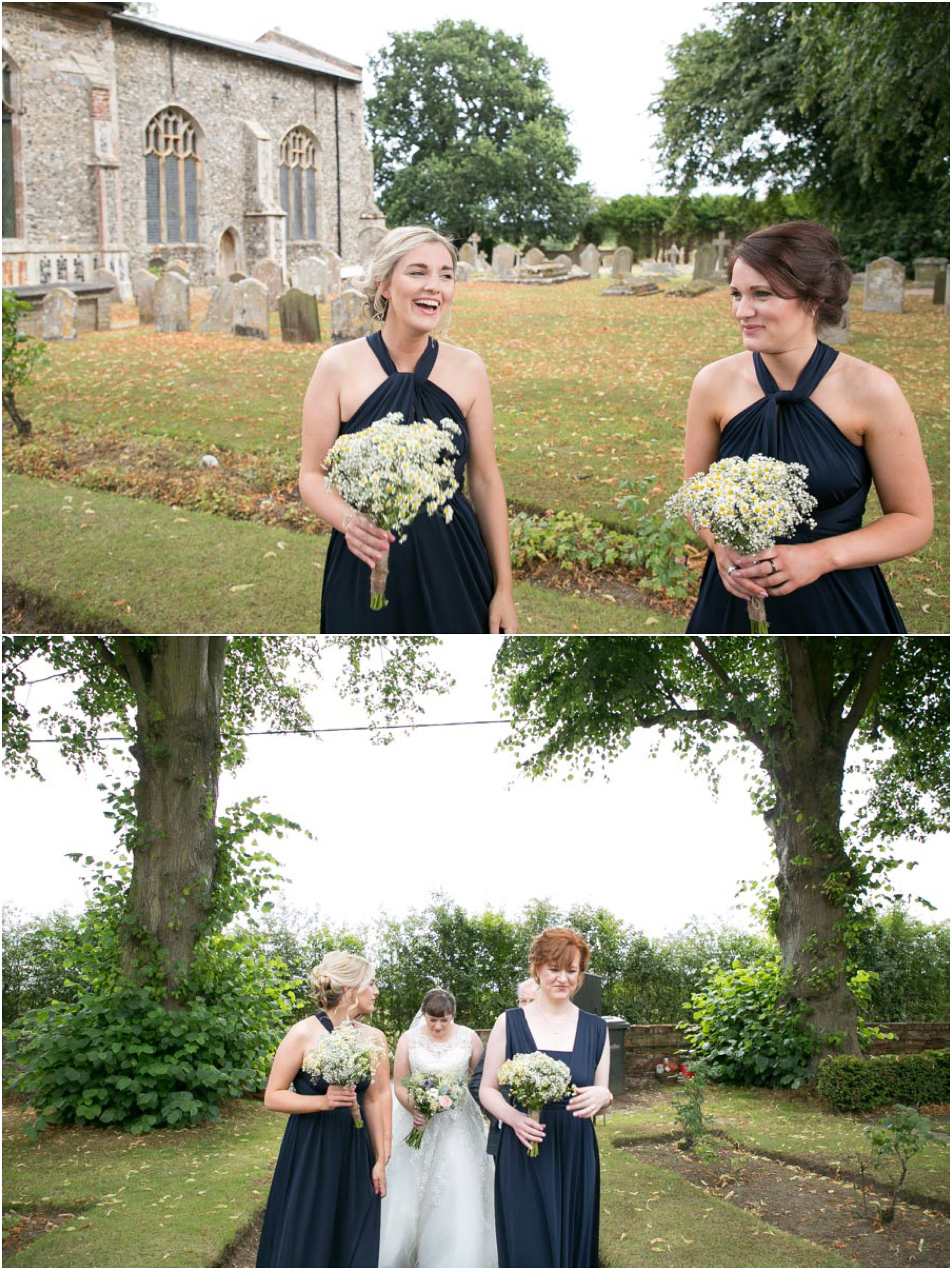 bridesmaids in navy blue at suffolk wedding outside church
