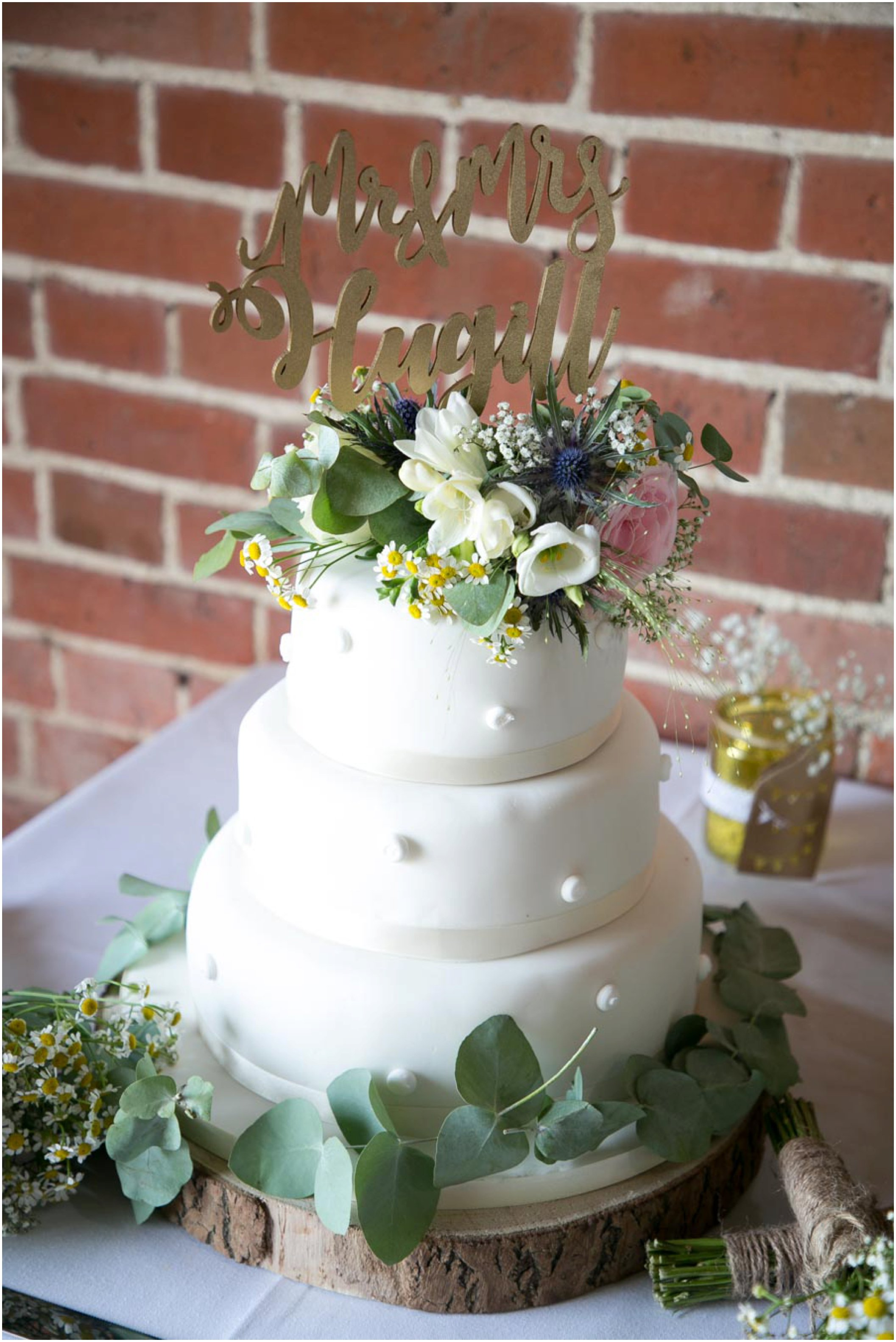 pretty white wedding cake with summer flowers
