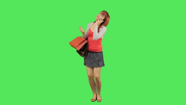 Female callling and holding shopping bags