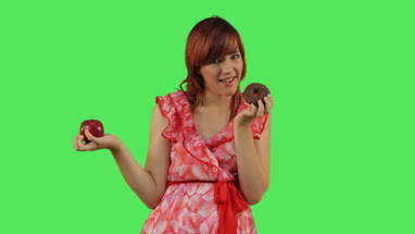 Woman deciding between Doughnut and Apple