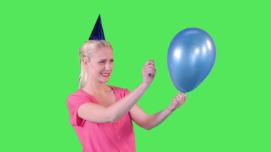 Female putting needle in balloon
