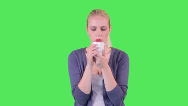 Female drinking a cup of tea