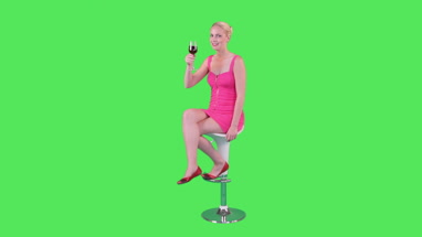 Female on chair holding up glass of wine