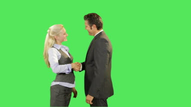 Business male and female shaking hands