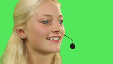 Female in call center talking on headphone