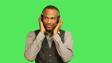 Male listening to music on headphones