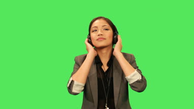 Asian female listening to music