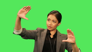 Asian female making hand gestures