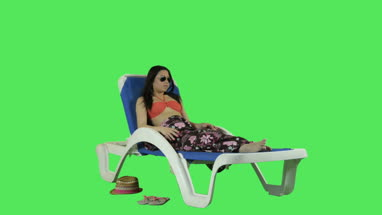 Female relaxing on sun bed