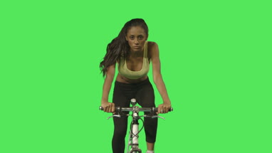 Female exercising on bicycle
